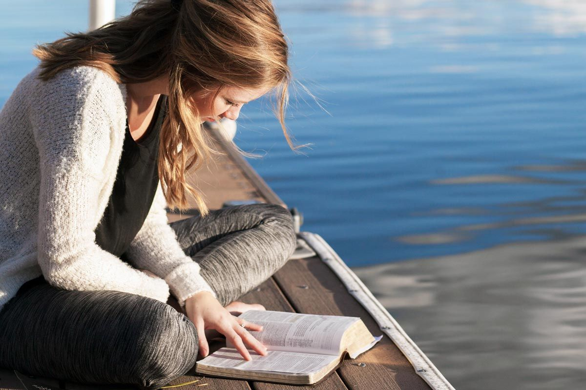 Photo of a woman reading the Bible finding strength through God's Word