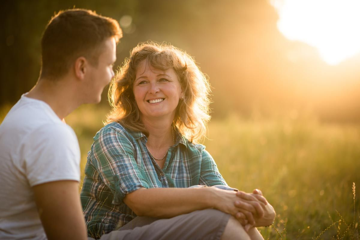 Photo of Mother with her adult son against nature background